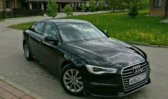 Черный седан Ауди A6